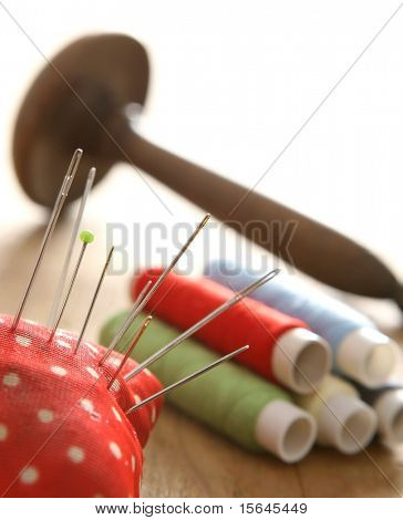 Colorful thread spools and needle