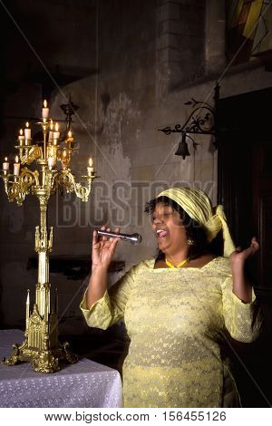 Gospel singer in a dark medieval church with 17th century interior