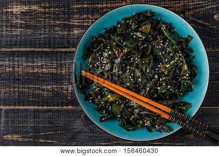 Wakame salad raw seaweed Japanese cuisine top view.