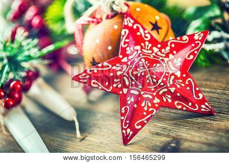 Christmas Time.Christmas Star and decoration. Christmas border design on the wooden background. Christmas jingle bells fir tree with christmas candle and decoration.