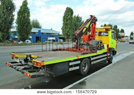 Tow truck on city street
