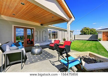Traditional Back Porch With Decking And A Roof Extension.