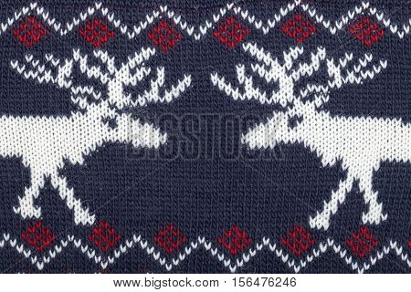 Deep blue knitted fabric with moose or elk ornament