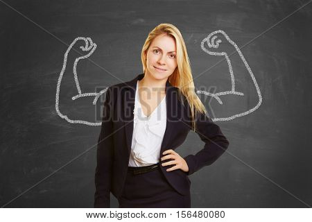 Successful self confident businesswoman with fake muscles made of chalk