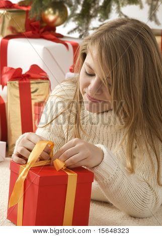 girl with a christmas hat and a present