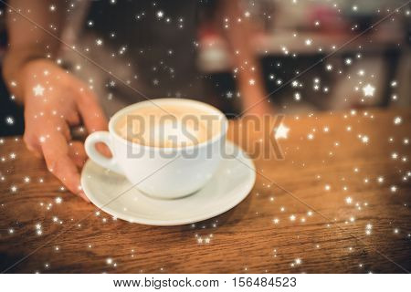 Snow against midsection of barista serving heart shape frothy coffee at cafe