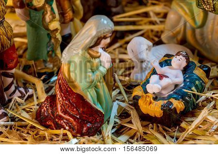 Christmas Manger scene with figurines including Jesus and Mary. Focus on baby Jesus!