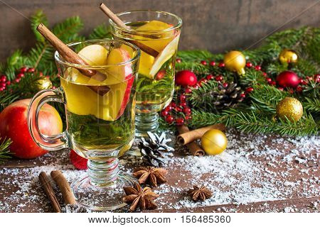 Spicy hot drink (cider punch tea) with apple orange cinnamon star anise for Christmas and winter holidays. close up