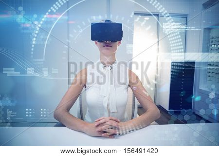 Composite image of face against businesswoman using virtual reality simulator with hands clapsed