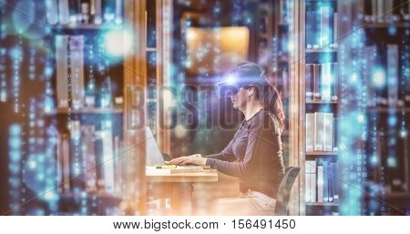 Digitally generated black and blue matrix against female student in virtual reality headset using laptop
