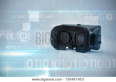 Blue technology design with binary code against close-up of virtual reality headset