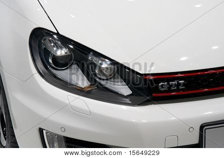 PARIS, FRANCE - OCTOBER 02: Paris Motor Show on October 02, 2008, showing Volkswagen Golf GTI, front light detail