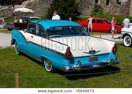 HAAPSALU, ESTONIA - JULY 18: American Beauty Car Show, showing white and blue 1956 Ford Fairlane 2D HT, rear view on July 18, 2009 in Haapsalu, Estonia