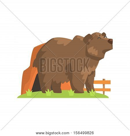Brown Bear Coming Out Of Bear Den Standing On Green Grass Patch In Open Air Zoo Enclosure. Wild Animal Enclosed In Outdoor Zoological Park. Cartoon Bear in Zoo Collection