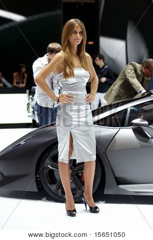 PARIS, FRANCE - SEPTEMBER 30: Paris Motor Show on September 30, 2010 in Paris, lady posing in Lamborghini stand