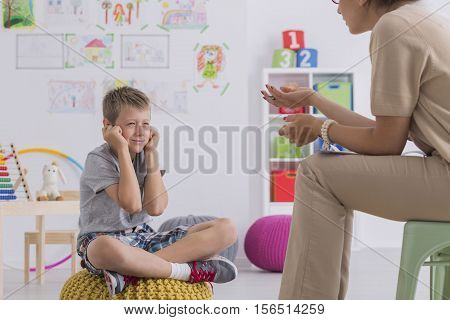Misbehaving Boy During Session With A Psychotherapist
