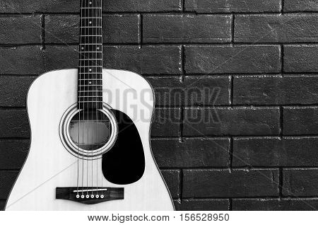 Music instrument Guitar on wall background poster