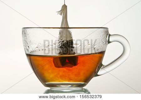 Brewing Up Hot Tea With Teabag Isolated On White Background