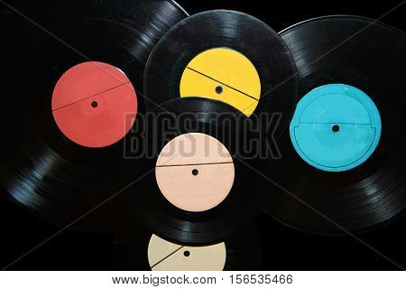 Vintage vinyl records with the music. Gramaphone plate isolated on black background.  Nineteenth  - twentieth century - most popular. Analog media sound information for patifon and gramophones.