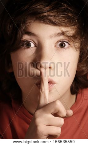 silence gesture boy ask for keep important secret from others mystery