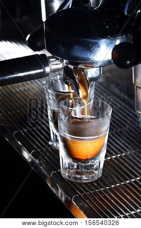 Espresso Machine Brewing A Coffee. Coffee Pouring Into Shot Glasses