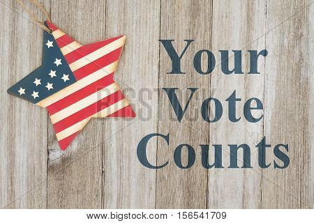 USA patriotic voting message USA patriotic old flag on a star with weathered wood background with text Your Vote Counts