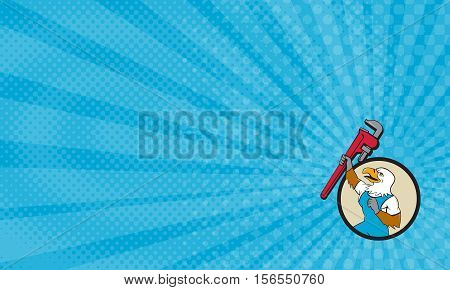 Business card showing Illustration of a american bald eagle plumber raising up giant pipe wrench adjustable wrench over head looking up viewed from the side set inside circle done in cartoon style.