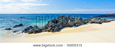 Gorgeous Beach Panorama with rocks in the foreground