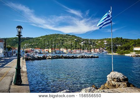 Greek flag at the port. Islands of Paxos Greece. Ionian sea