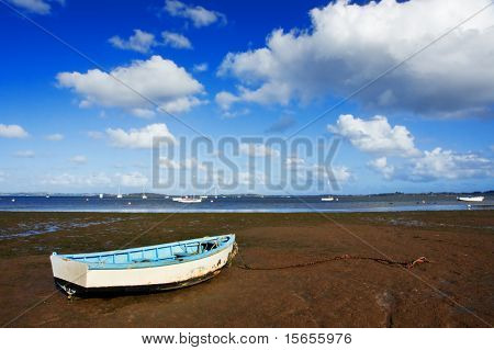 Row boat on mud flat