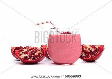Pomegranate Raspberry Smoothie In A Tumbler Glass With Pomegranate Pieces Isolated On White
