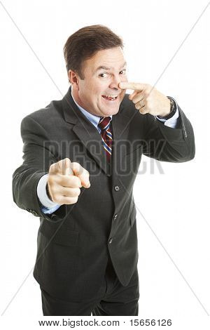 Businessman points to you and touches his nose - the symbol for
