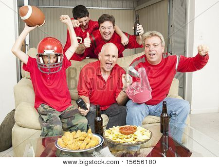 Family of football fans cheering for their favorite team.