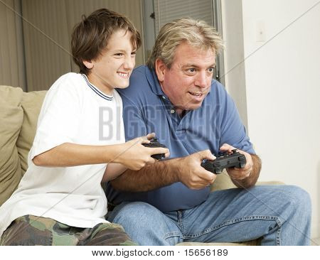 Father or uncle playing video games with a little boy - his son or nephew.