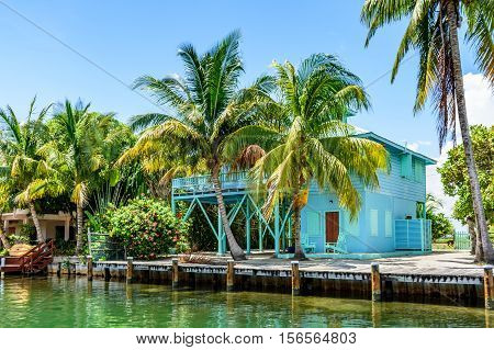 Placencia, Belize - August 28 2016: Tropical waterside house on lagoon side of Placencia in Belize, Central America