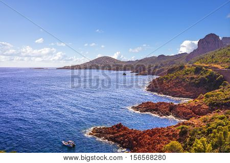 Esterel mediterranean red rocks coast beach and sea. French Riviera in Cote d Azur near Agay Cannes Saint Raphael Provence France Europe.