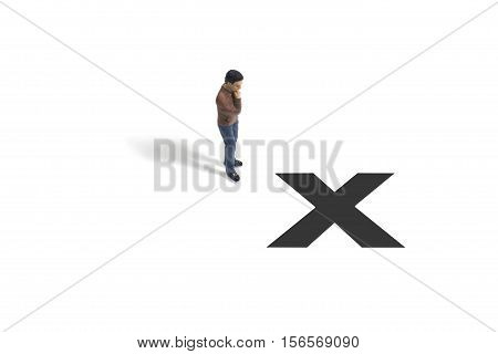 Toy Person Standing Next to X Mark on White Background
