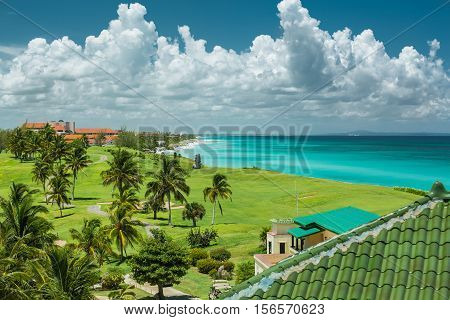 Great amazing, wide open view of tropical natural background, against tranquil azure ocean with magic fluffy clouds on dramatic blue sky