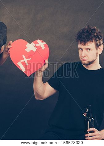 Woman And Man Addicted To Alcohol. Broken Heart.