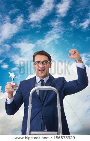 Businessman with star award against sky