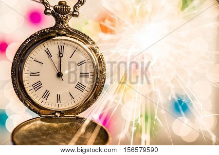 New year old clock on abstract background