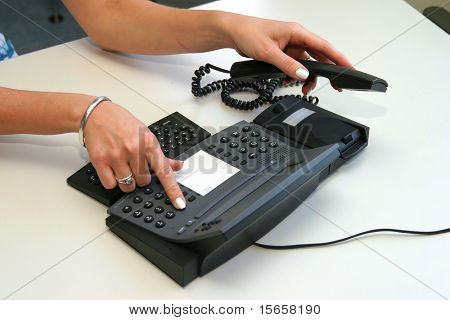 woman hand picking up telephone receiver