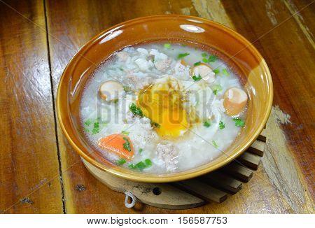 rice porridge with pork sausage topping creamy yolk on bowl