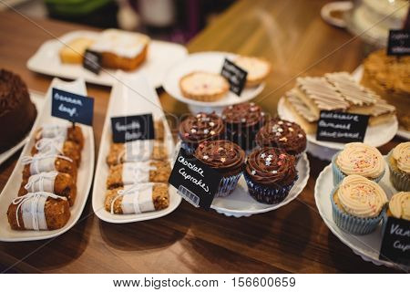 Close-up of various sweet food at counter in cake shop