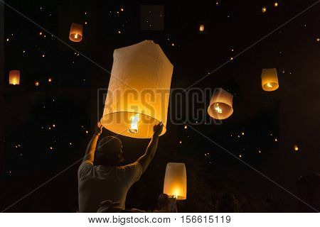 Loy Krathong Festival Balloon fire or yeepeng. Floating lantern on the Sky flying lanterns hot-air balloons in Chiang MaiThailand