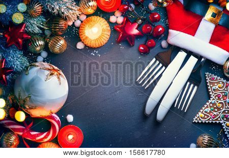 Christmas Dinner holiday table setting, Christmas and New Year celebration, served table with baubles, candles and Christmas decorations. Winter Holiday food background