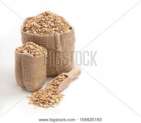 Two bags of oatmeal isolated on white background. Copy space high resolution product. Healthy food Concept.