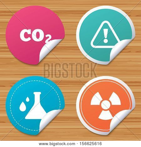 Round stickers or website banners. Attention and radiation icons. Chemistry flask sign. CO2 carbon dioxide symbol. Circle badges with bended corner. Vector