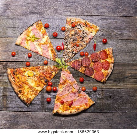 Diferent pizza parts on table table top view