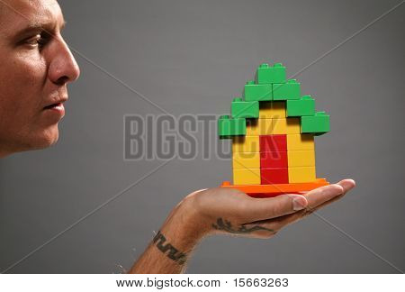 portrait man and house